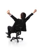 Successful excited Business man sitting in chair Royalty Free Stock Photos