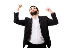 Successful excited businessman making fists. Stock Photos
