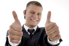 Successful executive with thumbs up hand gesture Stock Photo