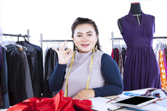 Successful fashion designer shows OK sign Stock Images