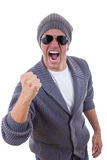 Successful fashion male model in sweater with sunglasses and cap Royalty Free Stock Photo