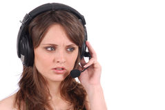 Successful female call centre employee speaking Stock Image