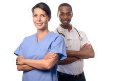 Successful female doctor in scrubs Stock Photo