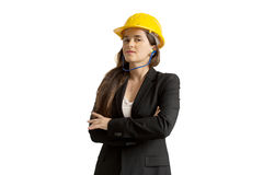 Successful female engineer with safety helmet and earplugs Stock Photography