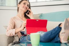 Successful female entrepreneur talking on mobile phone in a co-working space Royalty Free Stock Photography