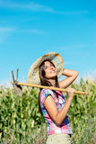 Successful female farmer in corn field Royalty Free Stock Image