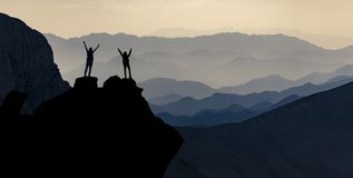 Summit of successful female mountaineers. Successful female mountaineers reaching the summit royalty free stock image