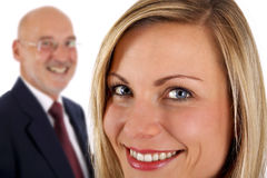 Successful female & senior male. Young successful smiling female with senior businessman in background (on white Stock Photos
