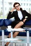 Successful female sitting in office Royalty Free Stock Images