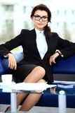 Successful female sitting in office Stock Photo