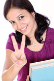 Successful female student. Young female student showing victory sign Stock Photo