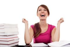 Successful female student with raised arms Stock Photo