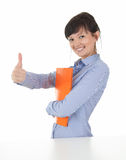 Successful female student with thumb up Stock Photo