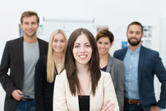 Successful female team leader. With a warm friendly smile standing with folded arms Stock Images