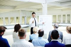 Report of expert. Successful financier making report by whiteboard for his colleagues at briefing stock photos