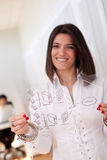 Successful firewall security solution. Happy businesswoman at her office showing a firewall schema (selective focus with shallow DOF Stock Photos
