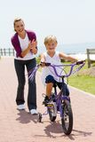 Successful first ride. Happy little girl riding bicycle for the first time Royalty Free Stock Photo