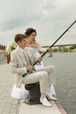 Successful fishing of a newly-married couple Stock Photography