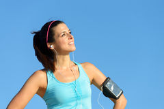 Successful fitness woman with sport armband Stock Images