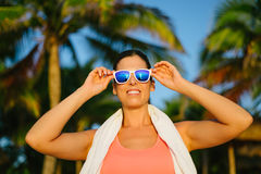 Successful fitness woman with sunglasses Stock Photo