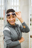 Successful fitness woman wearing sunglasses and smiling Stock Photo