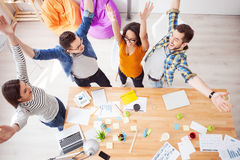 Successful four colleagues are expressing positive emotions Royalty Free Stock Image