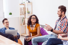 Successful friendly team are discussing new project Stock Photos