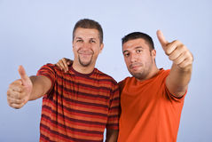 Successful friends give thumbs up Stock Photo