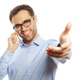 Successful gesturing business man with mobile Royalty Free Stock Image