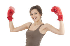 Successful girl in boxing gloves Royalty Free Stock Image