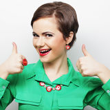 Successful girl gives thumb up with two hands Royalty Free Stock Photos
