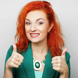 Successful girl gives thumb up with two hands Stock Image