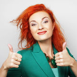Successful girl gives thumb up with two hands Royalty Free Stock Images