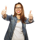 Successful girl gives thumb up with two hands Royalty Free Stock Photography