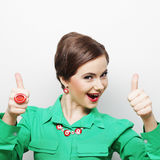 Successful girl gives thumb up with two hands Stock Photos
