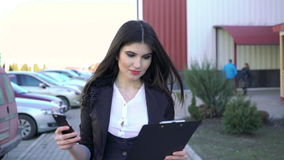 Successful girl is going using phone and notebook stock video