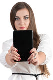 Successful girl holding a computer and typing on a keyboard Royalty Free Stock Photos