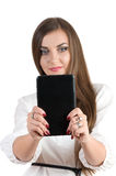 Successful girl holding a computer and typing on a keyboard Stock Photo