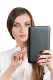 Successful girl holding a computer and typing on a keyboard Stock Image