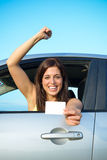 Successful girl passing car driving license test Stock Images