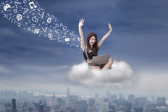 Successful girl sending message from the cloud Royalty Free Stock Images