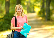Successful girl student with books in the Park Royalty Free Stock Image