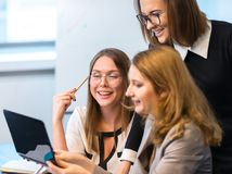 Successful girls working in the office Stock Photo