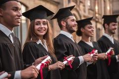 Happy young alumni royalty free stock photos