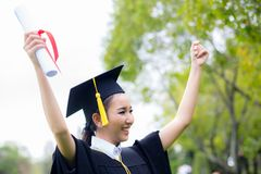 Successful graduating student with nature background, Happy graduated student girl. Successful graduating student with nature background, Happy graduated Stock Image