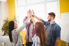 Successful graphic team giving high-five Stock Photos