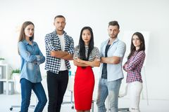 Successful group of business people with crossed arms in the off. Ice. Team work concept Stock Photos