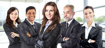 Successful group of business people in an office facing each other wedge. Successful group of business people at the office Royalty Free Stock Photo