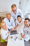 Successful group of doctors. As a team in meeting at medical clinic Royalty Free Stock Photography