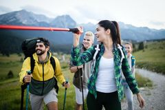 Successful Group of Happy Friends on Mountain Top, Cheering. Successful Group of HappyYoung Friends on Mountain Top, Cheering royalty free stock photos